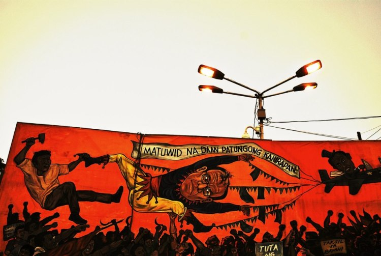 Mural at a labour day protest in Manila, Philippines.  The international labour movement has historically been at the forefront of alter-globalisation  protests, challenging  mainstream notions of capitalist development with its ever greater assaults on the working class at the turn of the century. (Photo by CJ Chanco)